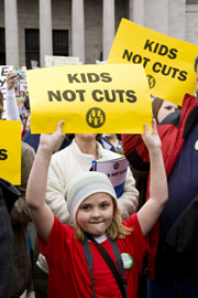 "Child holding ""Kids Not Cuts"" sign, Olympia, Feb. 2010"