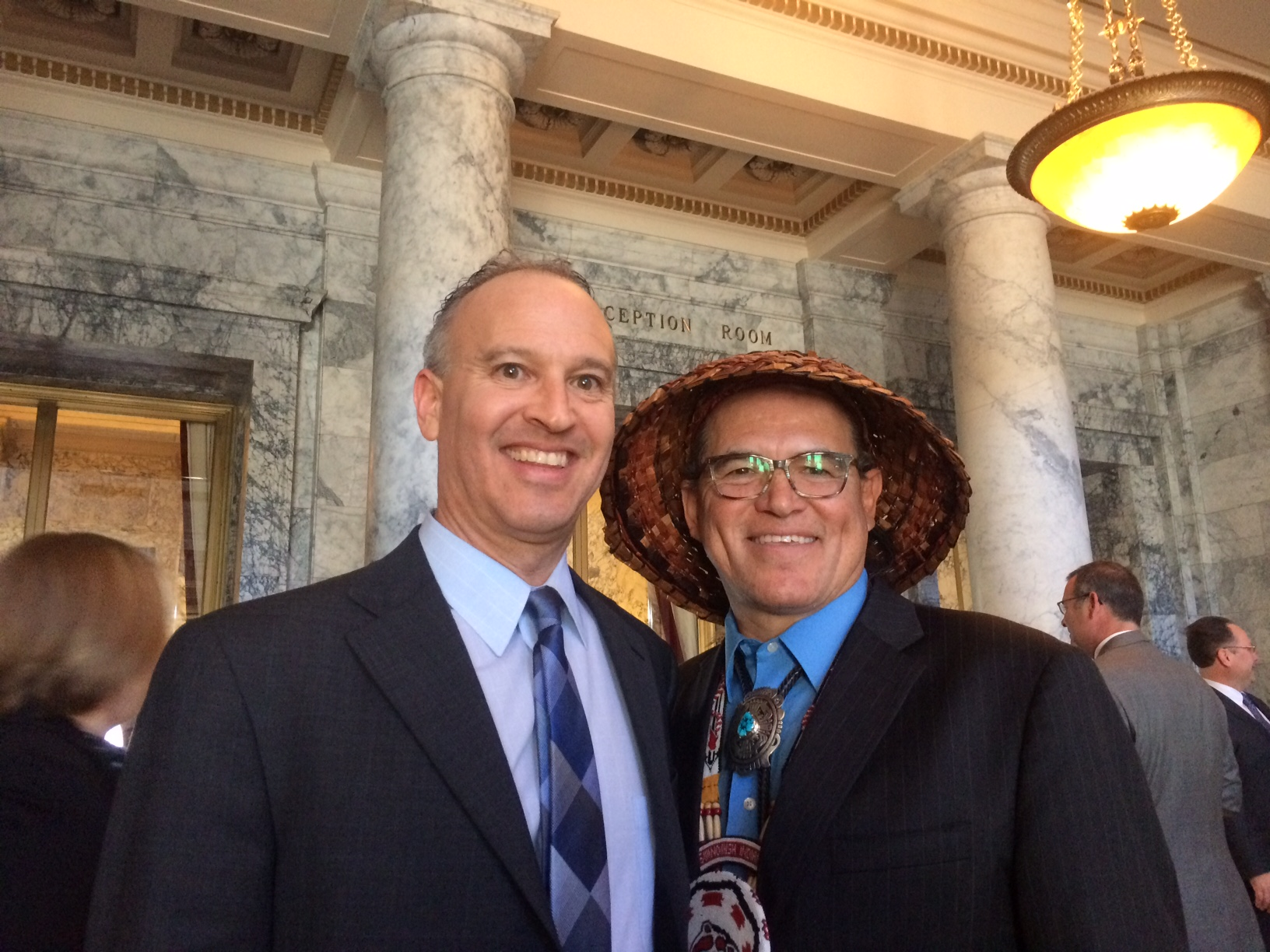 Deputy director Jon Gould with Swinomish Indian Tribal Community chairman and president of the National Congress of American Indians, Brian Cladoosby, at the bill signing ceremony for Senate Bill 5079.
