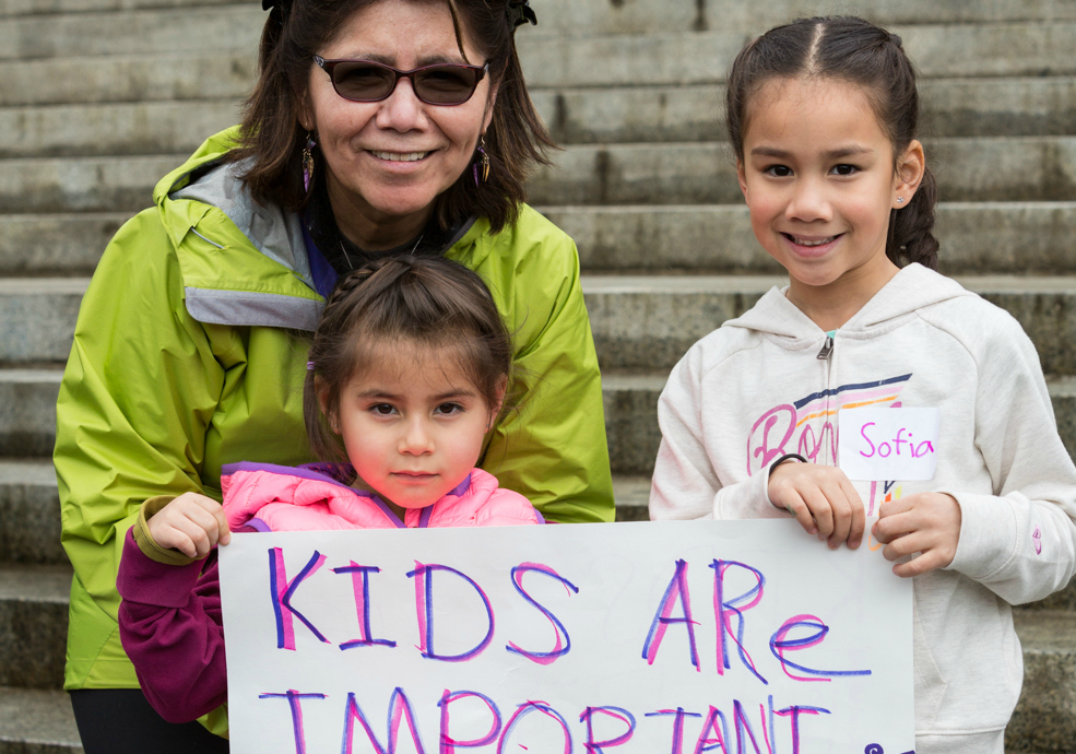 Alicia Luna & two of her granddaughters outside the state capitol.