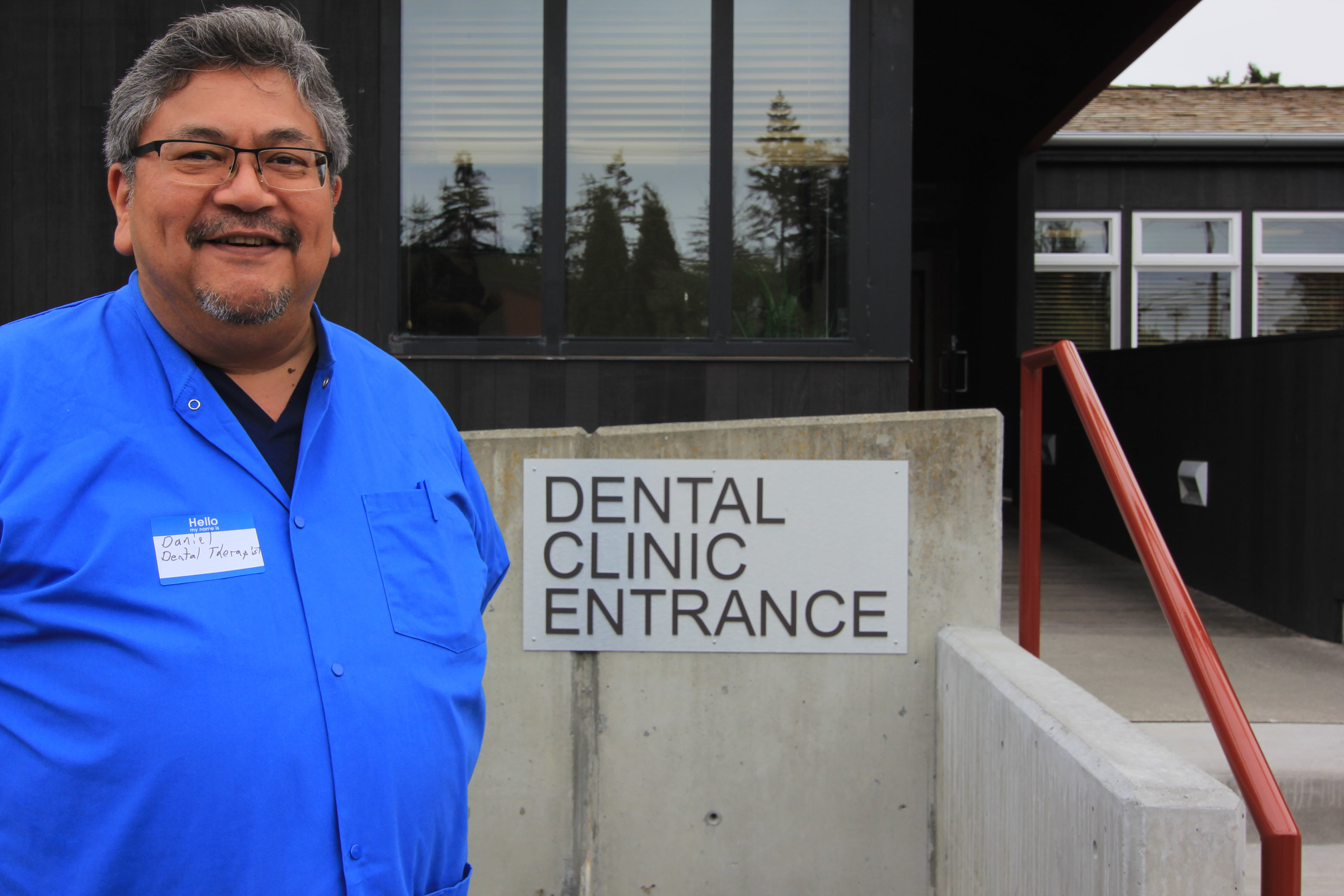 Daniel Kennedy, practicing Dental Therapist, at the entrance to the Swinomish Tribal Dental Clinic