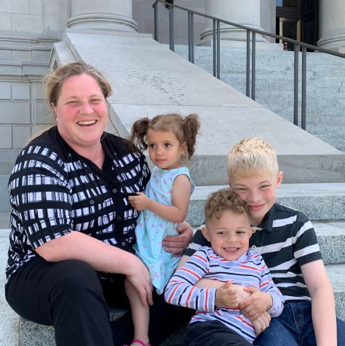 Tacoma's Kelly Blucher at the state capitol with her three children